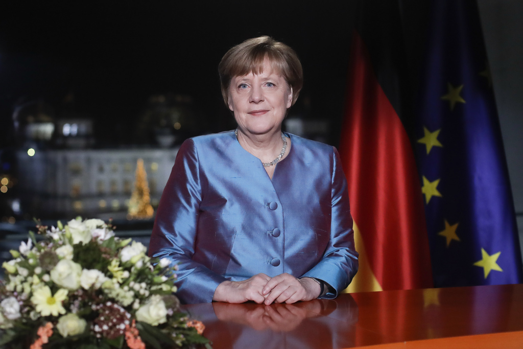 German Chancellor Angela Merkel poses for photographs after the television recording of her annual New Year's speech at the chancellery...