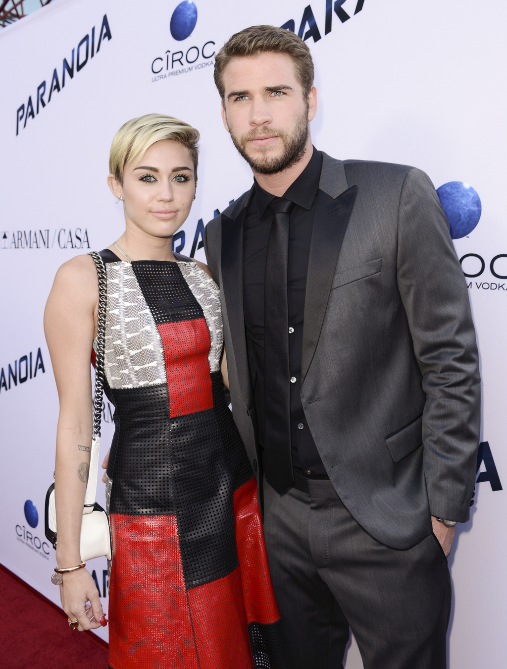 FILE - In this Aug. 8, 2013, file photo, actor Liam Hemsworth and singer and actress Miley Cyrus arrive on the red carpet at the US pre...