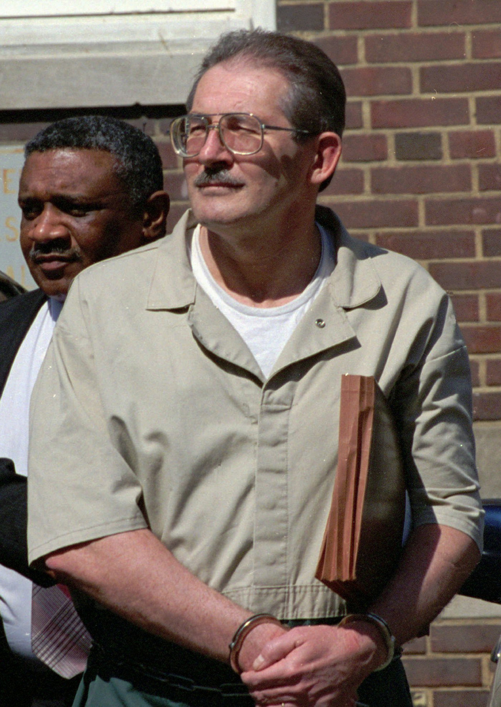 FILE - In this April 28, 1994 file photo, former CIA agent Aldrich Ames leaves federal court in Alexandria, Va. U.S. relations with Mos...