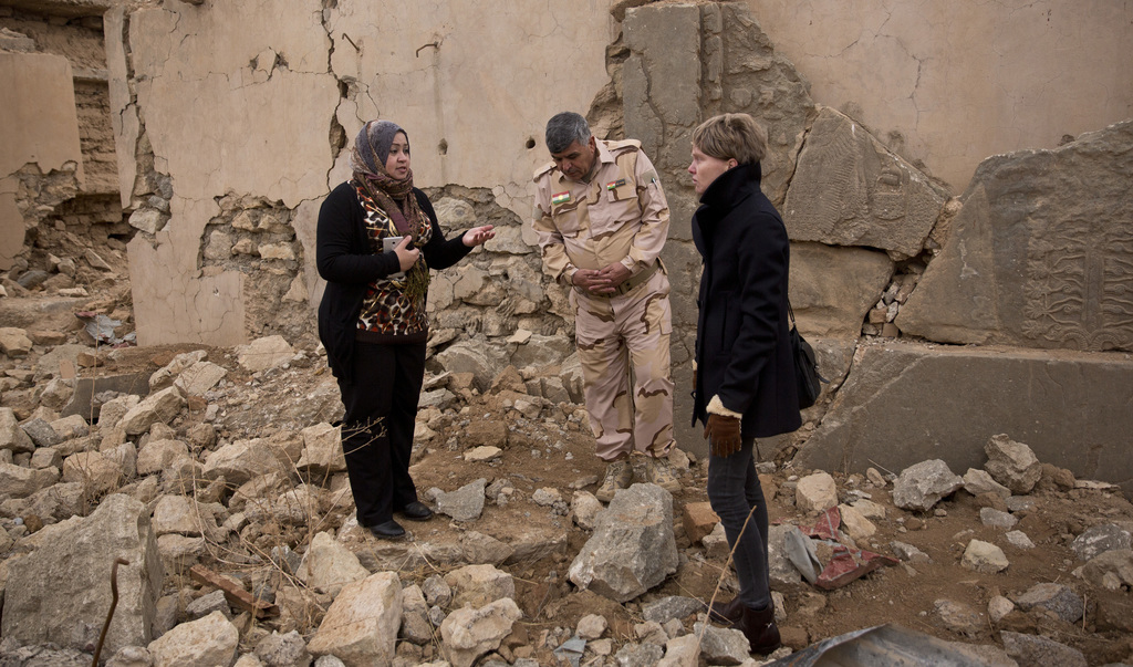 Iraq archaeologist Layla Salih, left, confers with UNESCO's representative in Iraq Louise Haxthausen, right, at the ancient site of Nim...