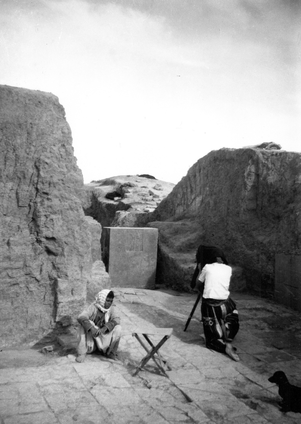 This 1951 photo by British mystery writer Agatha Christie shows archaeologist Barbara Parker taking a photograph at the ancient Assyria...