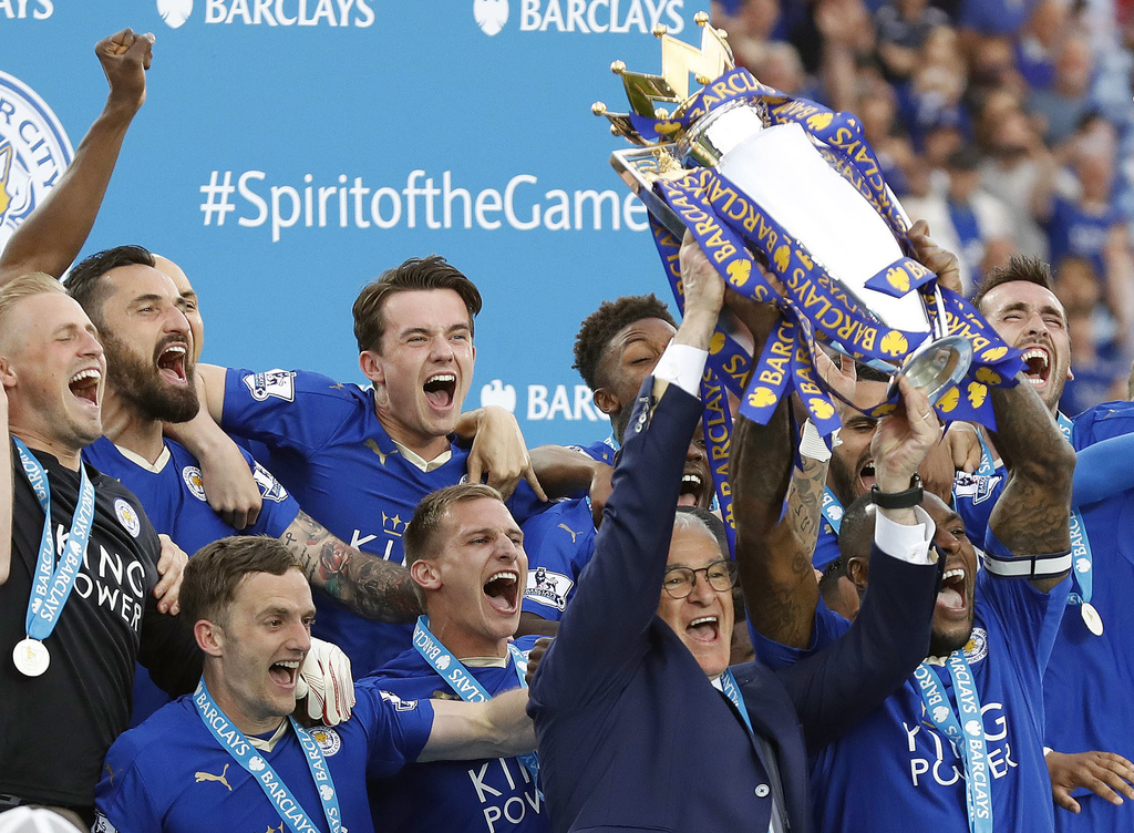 FILE - In this May 7, 2016, file photo, Leicester manager Claudio Ranieri and Leicester's Wes Morgan lift the trophy as Leicester City ...