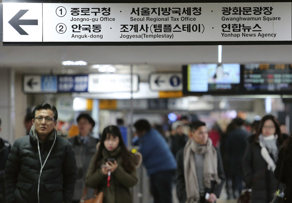 In this Thursday, Dec. 29 photo, a dual-language street sign written in Korean and English is displayed at a subway station in Seoul, S...