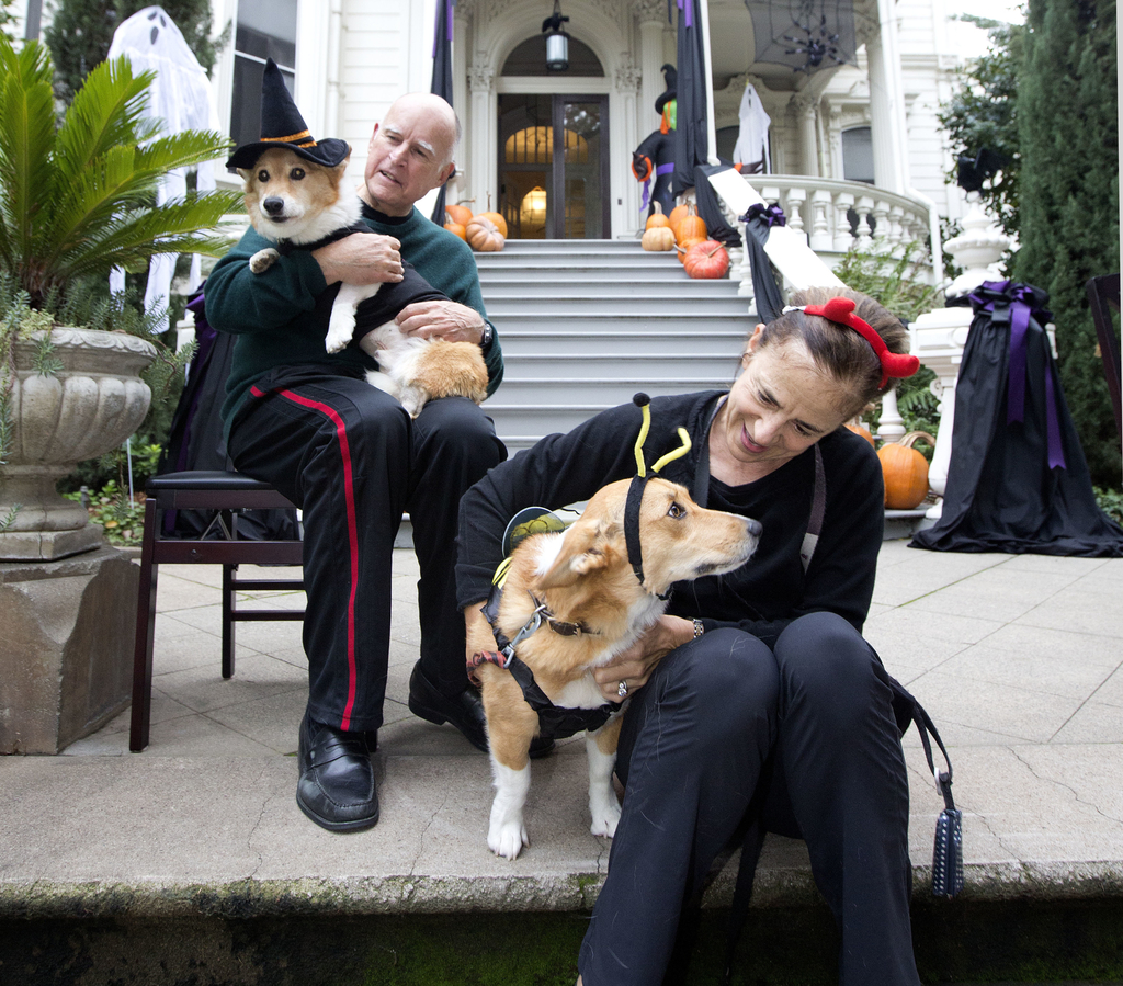 FILE - In this Oct. 31, 2016, file photo, California Gov. Jerry Brown holds first dog, Sutter, as his wife, Anne Gust Brown holds deput...
