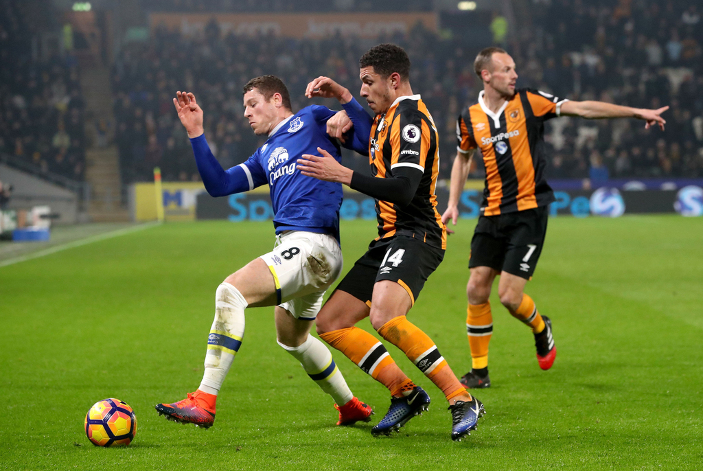 Everton's Ross Barkley left, and Hull City's Jake Livermore in action during the English Premier League soccer match at the KCOM Stadiu...
