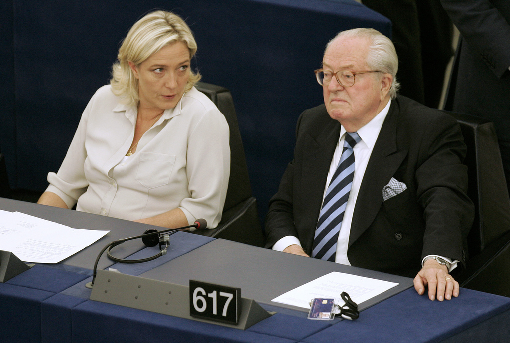 FILE - In this July 14, 2009 file photo Jean-Marie Le Pen, right, and his daughter Marine Le Pen sit at the European Parliament, in Str...