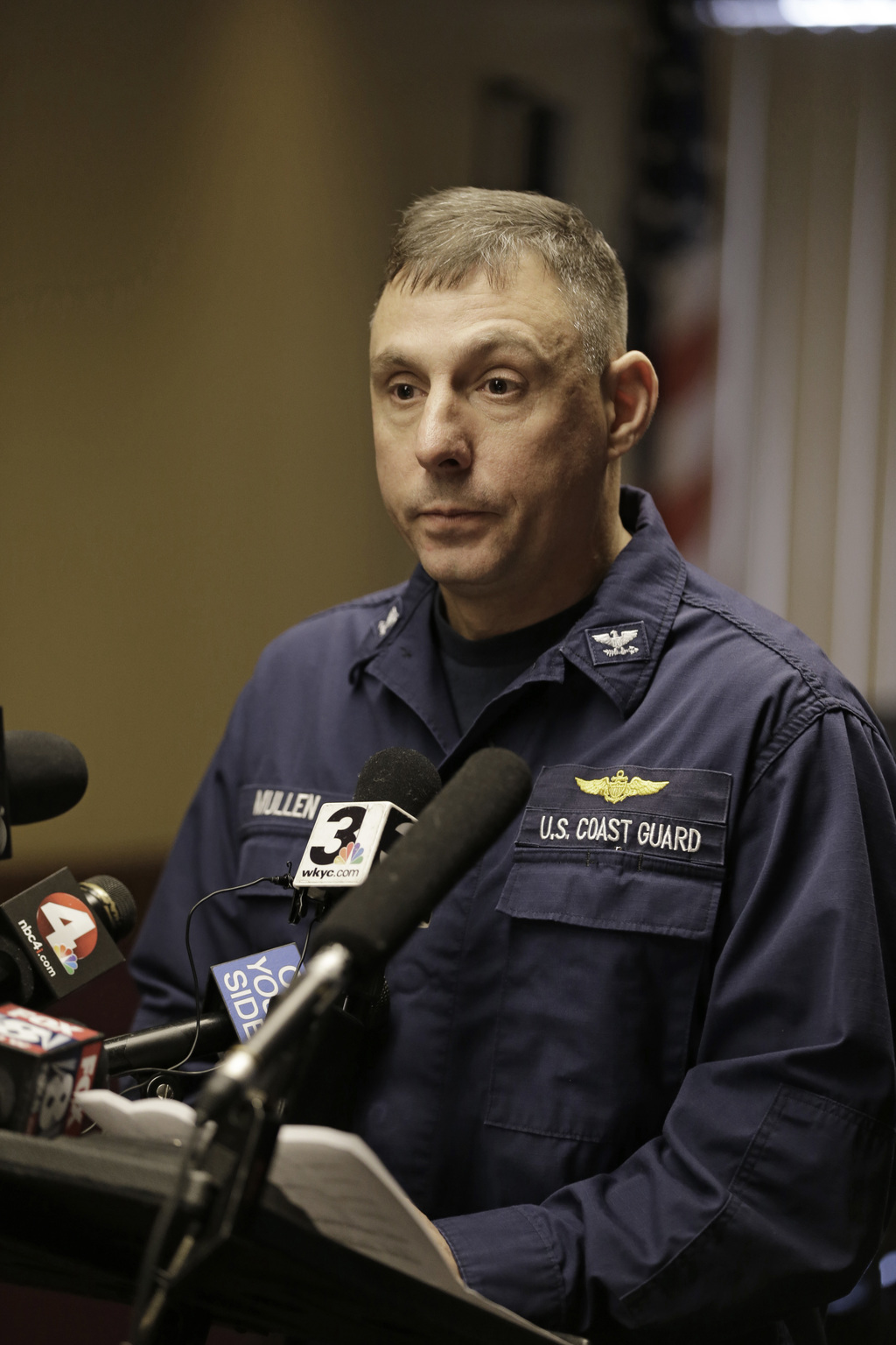 Capt. Michael Mullen of the U.S. Coast Guard answers questions during a news conference at Burke Lakefront Airport, Friday, Dec. 30, 20...