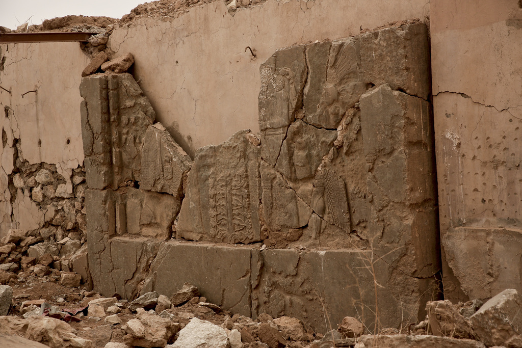 An ancient relief lies shattered in the Northwest Palace at the nearly 3,000-year-old site of Nimrud, Iraq, in this Wednesday, Dec. 14,...