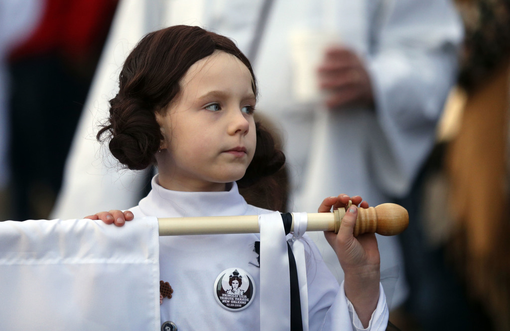 """Addy Longlois, 7, dressed as Princess Leia, walks in a parade in honor of actress Carrie Fisher, who played Princess Leia in the """"Star ..."""