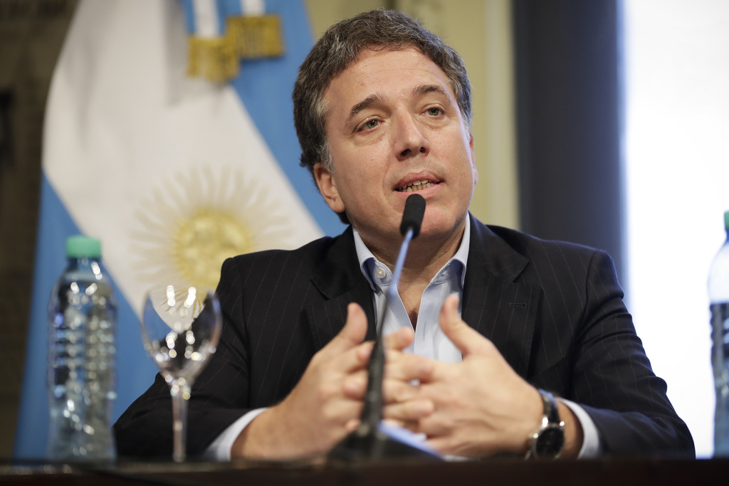 Argentina's new Treasury Minister Nicolas Dujovne gives a news conference at Casa Rosada presidential palace in Buenos Aires, Argentina...
