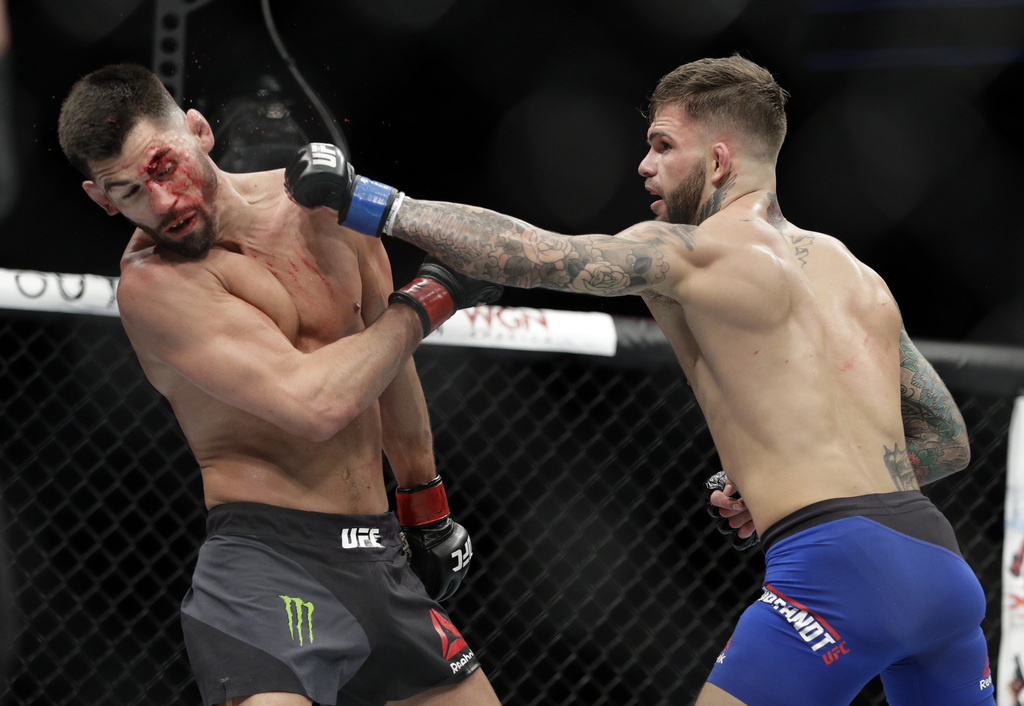 Cody Garbrandt, right, throws a punch to Dominick Cruz during a bantamweight championship mixed martial arts bout at UFC 207, Friday, D...