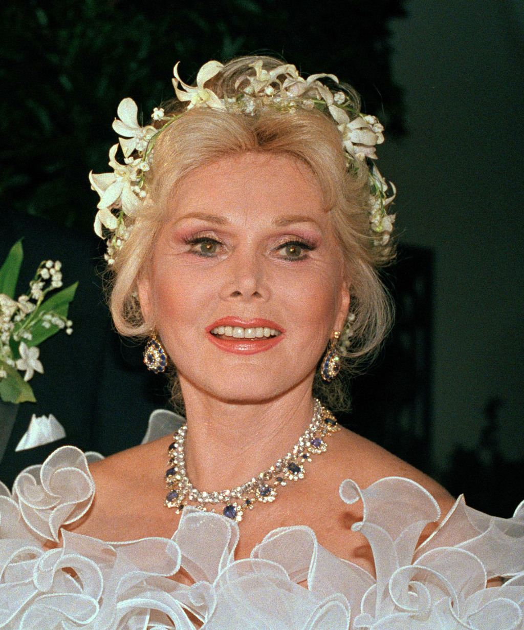 FILE- In this Aug. 15, 1986 file photo, actress Zsa Zsa Gabor smiles in Los Angeles. Gabor was remembered at a funeral mass Friday, Dec...