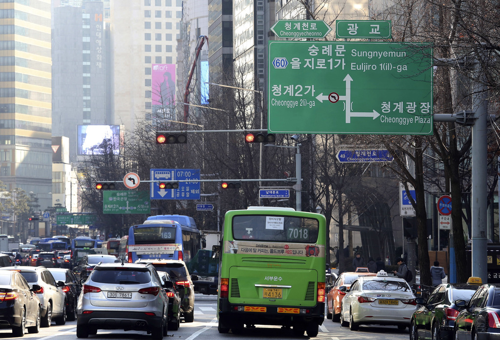 In this Wednesday, Dec. 28 photo, a dual-language traffic sign written in Korean and English is displayed over the road in Seoul, South...