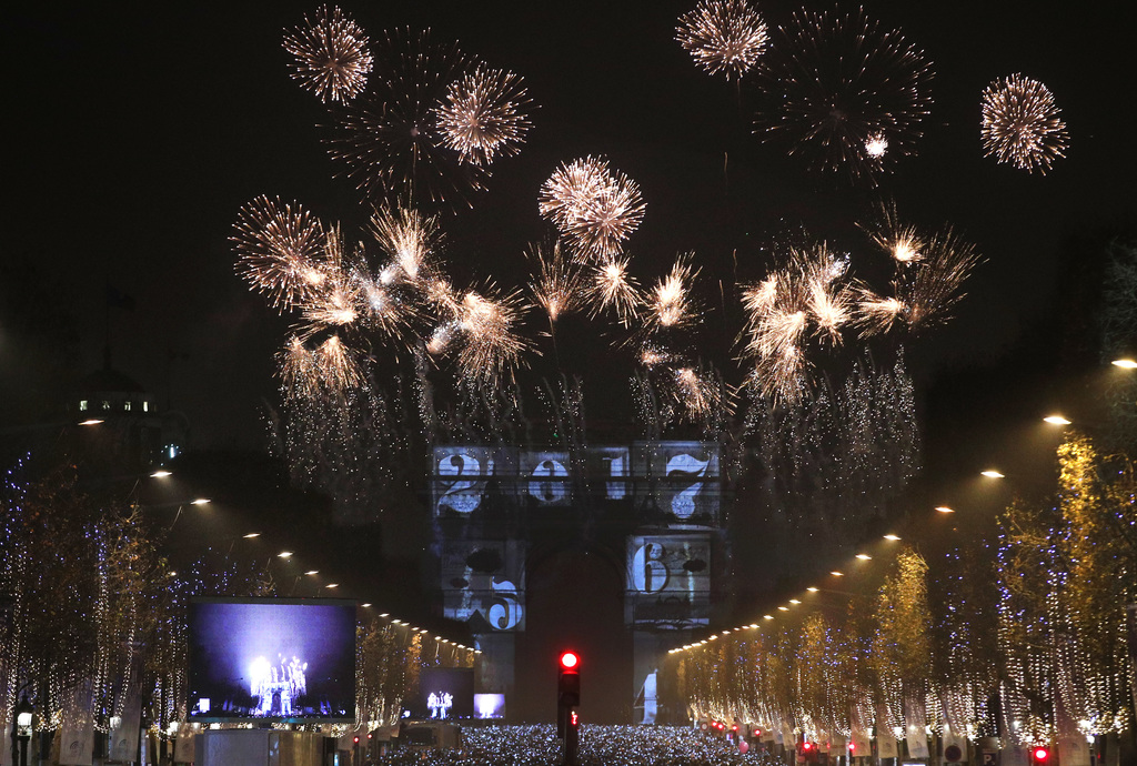 The 2017 appears during a firework over the Arc de Triomphe as part of the New Year celebrations on the Champs Elysees, in Paris, Franc...