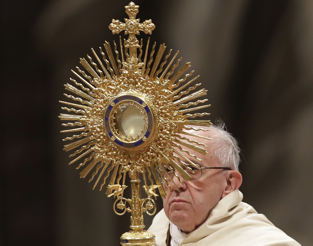 Pope Francis holds a monstrance as he celebrates a new year's eve vespers Mass in St. Peter's Basilica at the Vatican, Saturday, Dec. 3...