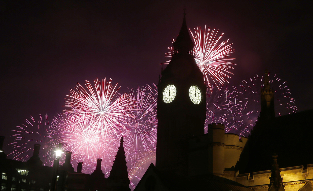Fireworks explode over Elizabeth Tower housing the Big Ben clock to celebrate the New Year in London, Sunday, Jan. 1, 2017.(AP Photo/Fr...