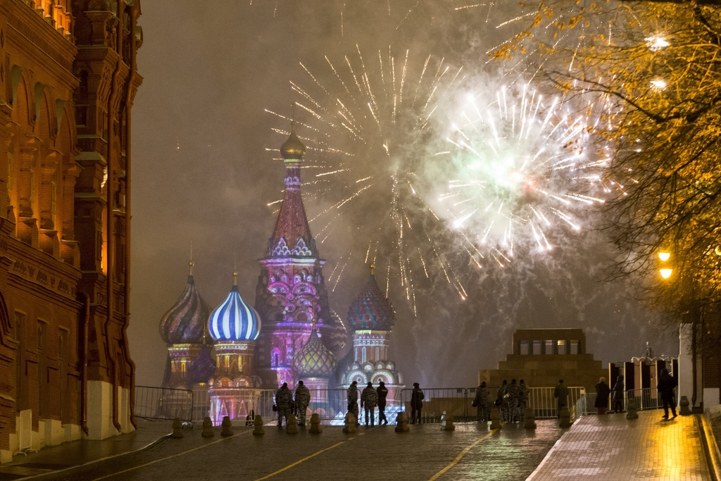 Fireworks explode over the Kremlin in Red Square which was blocked by police during New Year celebrations in Moscow, Russia, Sunday, Ja...