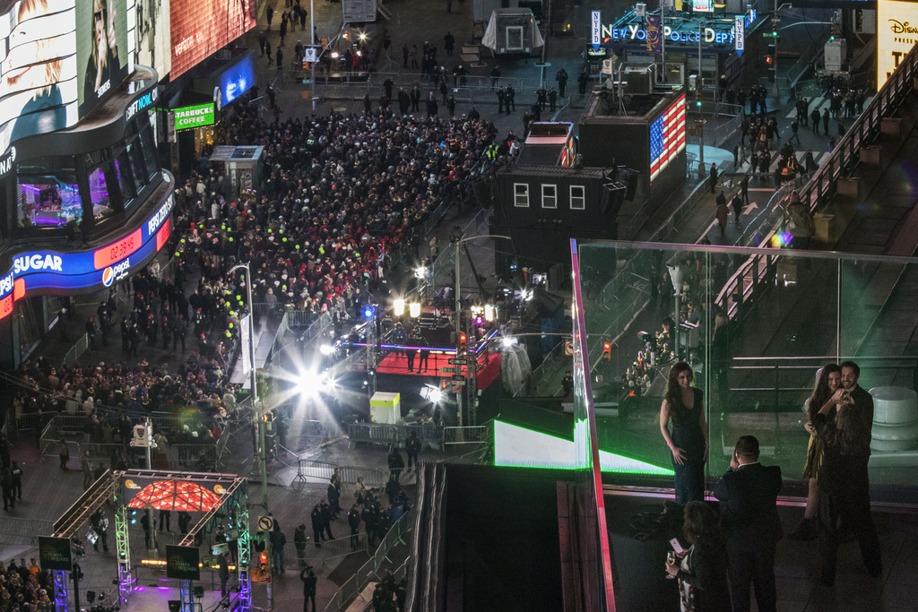 Revelers take part in the New Year's Eve celebration in New York's Times Square as seen from the Marriott Marquis, Saturday, Dec. 31, 2...