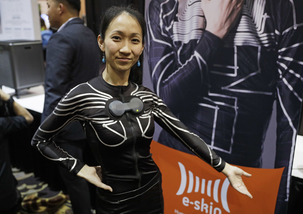 A woman wears an e-skin shirt at the Xenoma booth during CES Unveiled before CES International, Tuesday, Jan. 3, 2017, in Las Vegas. Th...