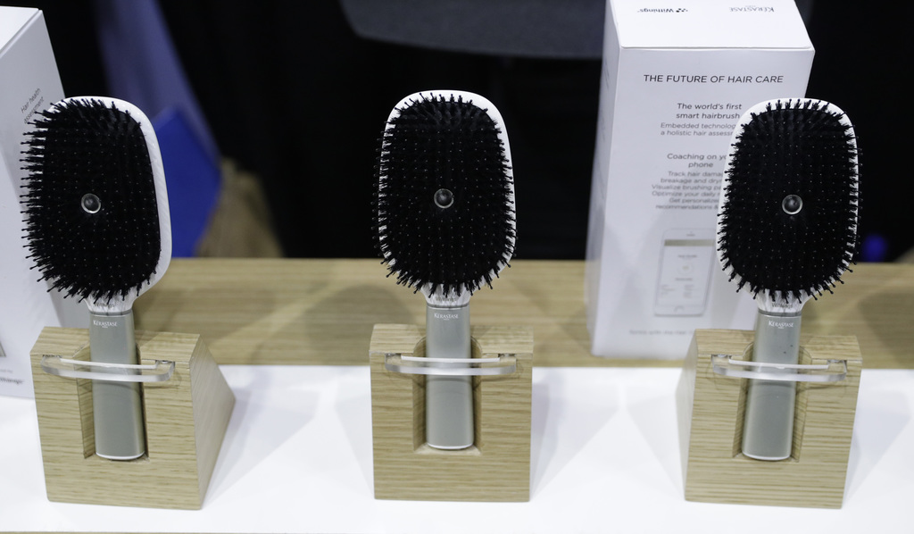 Hair Coach smart hairbrushes are displayed at the Withings booth during CES Unveiled before CES International, Tuesday, Jan. 3, 2017, i...