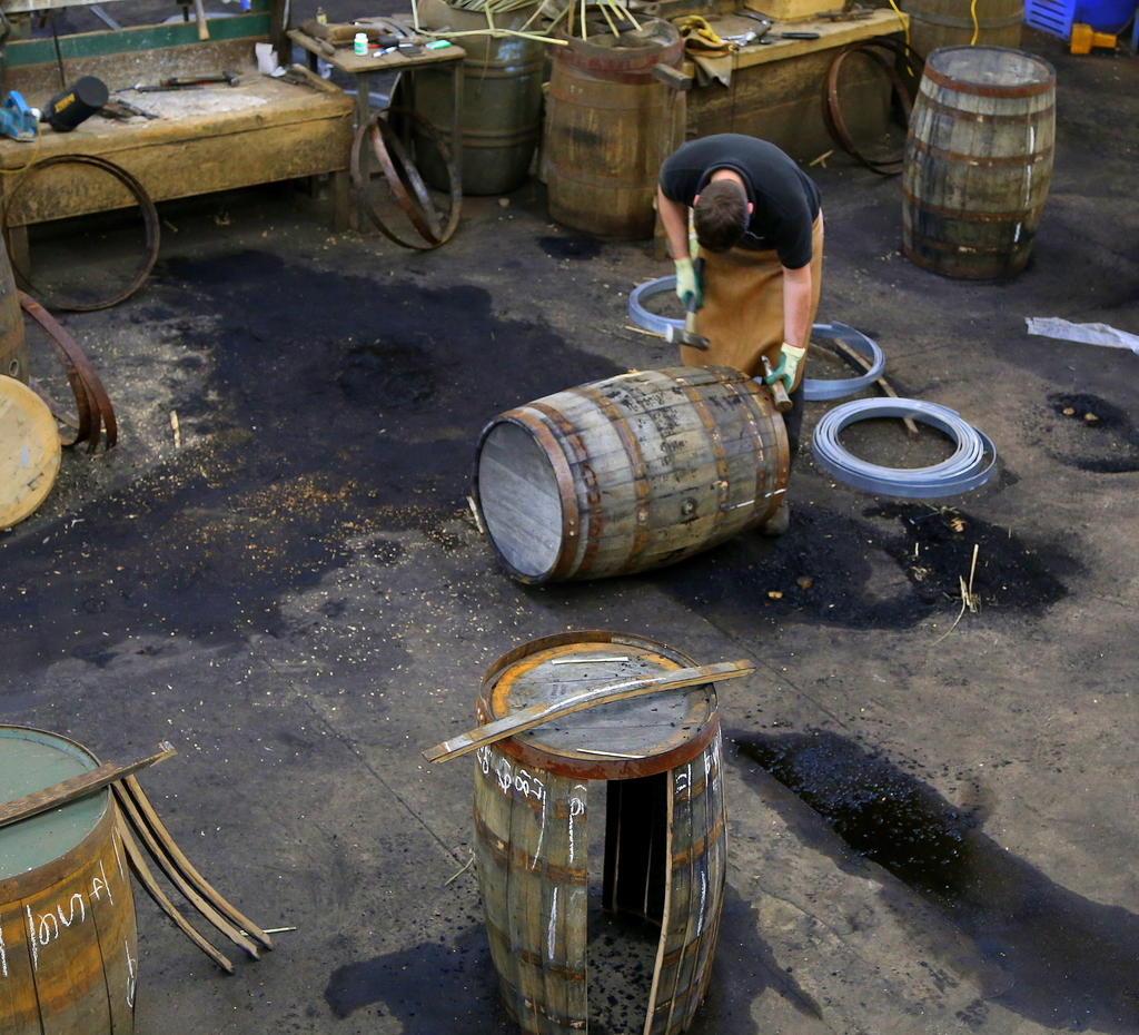 In this photo taken June 28, 2016, a worker at the cooperage of the Balvenie distillery in Dufftown, in the Speyside region of Scotland...