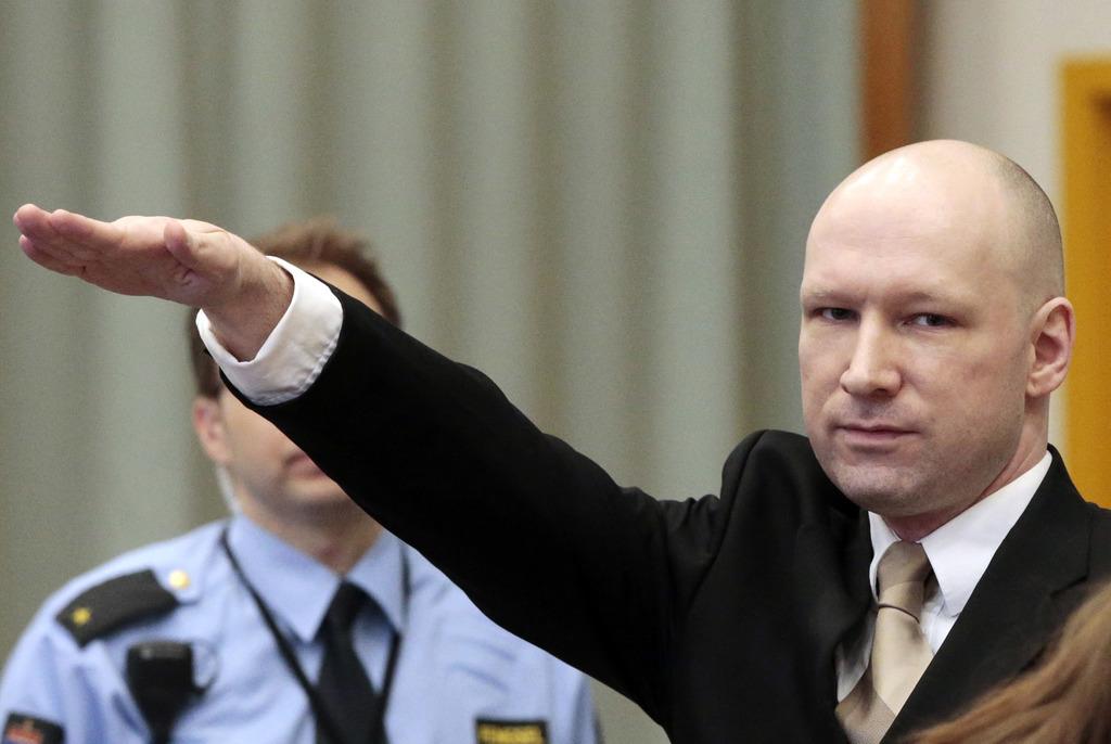 FILE - In this Tuesday, March 15, 2015 file photo, Anders Behring Breivik gestures as he enters a courtroom in Skien, Norway. Breivik, ...