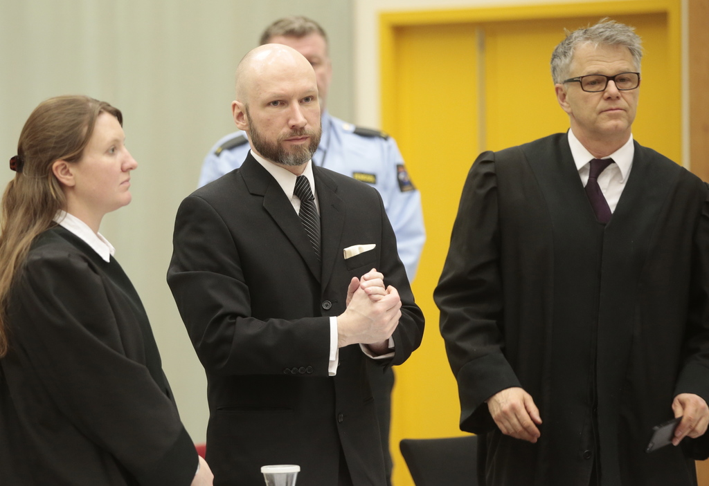 Anders Behring Breivik, center, arrives for his appeal case flanked by his defense lawyers Mona Danielsen, left, and Oystein Storrvik i...