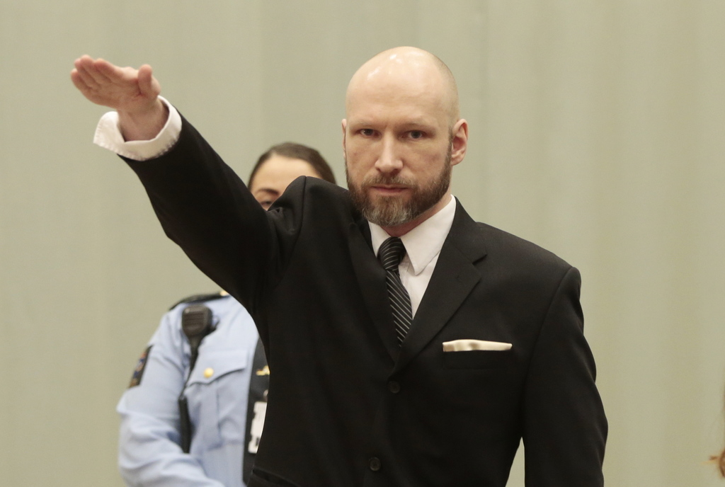 Anders Behring Breivik raises his right hand at the start of his appeal case in Borgarting Court of Appeal at Telemark prison in Skien,...