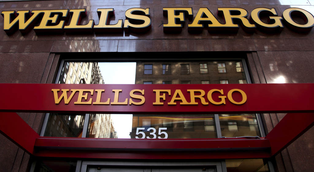 FILE - This May 6, 2012, file photo, shows a Wells Fargo sign at a branch in New York. Wells Fargo announced Tuesday, Jan. 10, 2017, it...