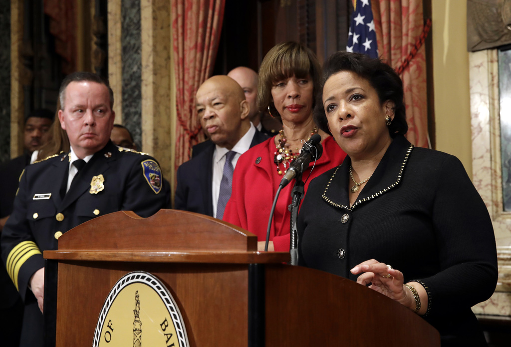 Attorney General Loretta Lynch, right, speaks during a joint news conference in Baltimore, Thursday, Jan. 12, 2017, to announce the Bal...