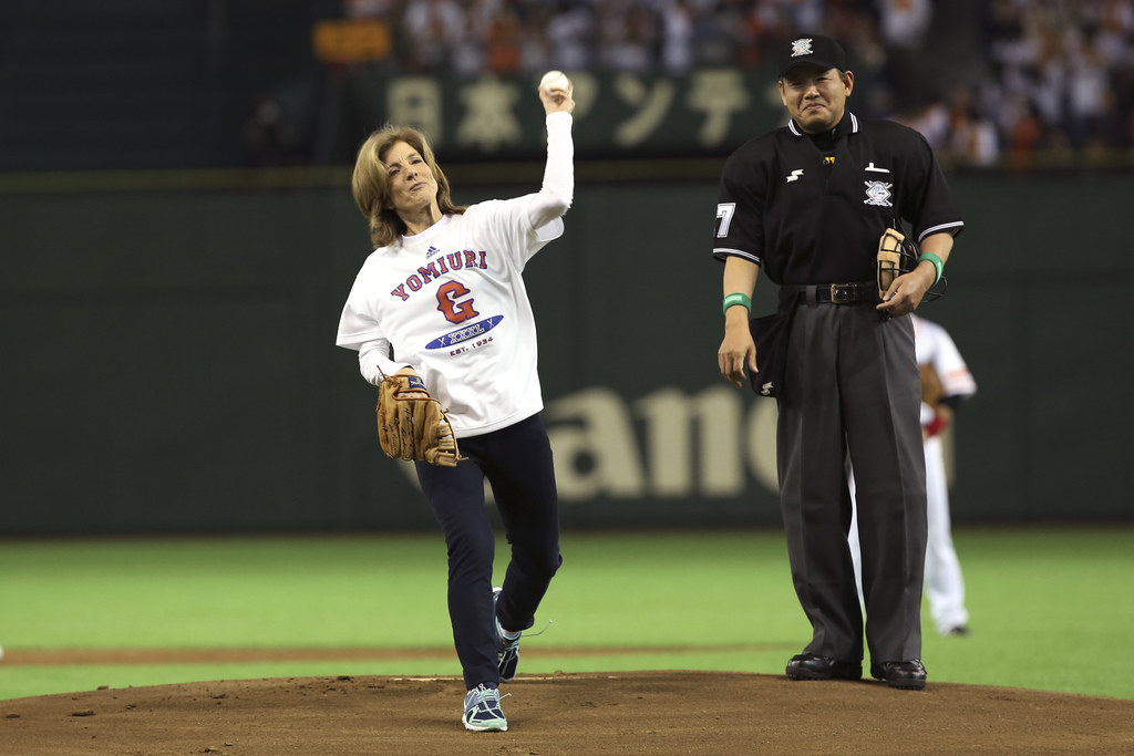FILE - In this March 28, 2014, file photo, U.S. Ambassador to Japan Caroline Kennedy throws out the ceremonial first pitch before the J...