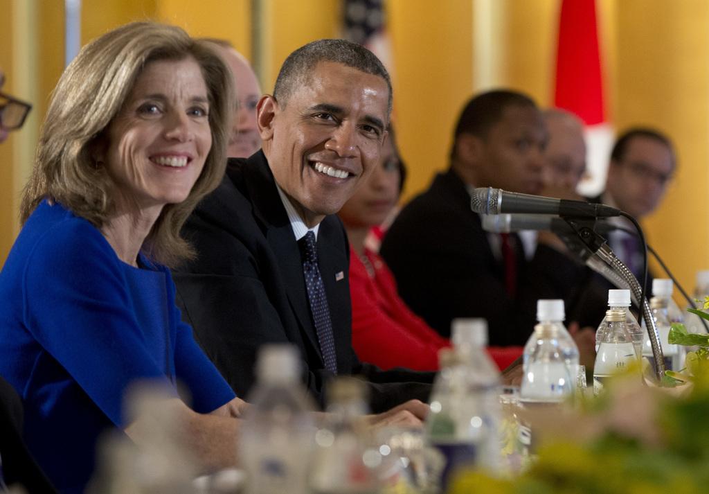 FILE - In this April 24, 2014, file photo, President Barack Obama sits with U.S. Ambassador to Japan Caroline Kennedy, left, during a b...