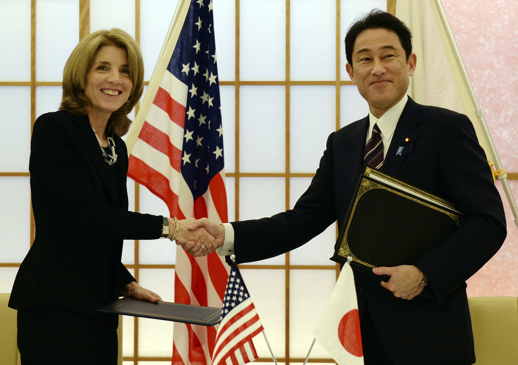 FILE - In this April 23, 2014, file photo, U.S. Ambassador to Japan Caroline Kennedy, left, shakes hands with Japanese Foreign Minister...