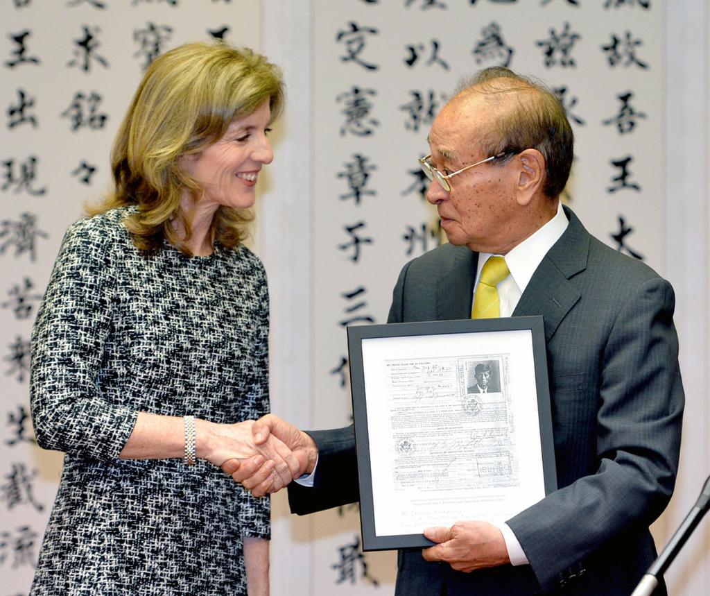 FILE- In this Feb. 12, 2014, file photo, U.S. Ambassador to Japan Caroline Kennedy, left, shakes hands with Okinawa Gov. Hirokazu Nakai...