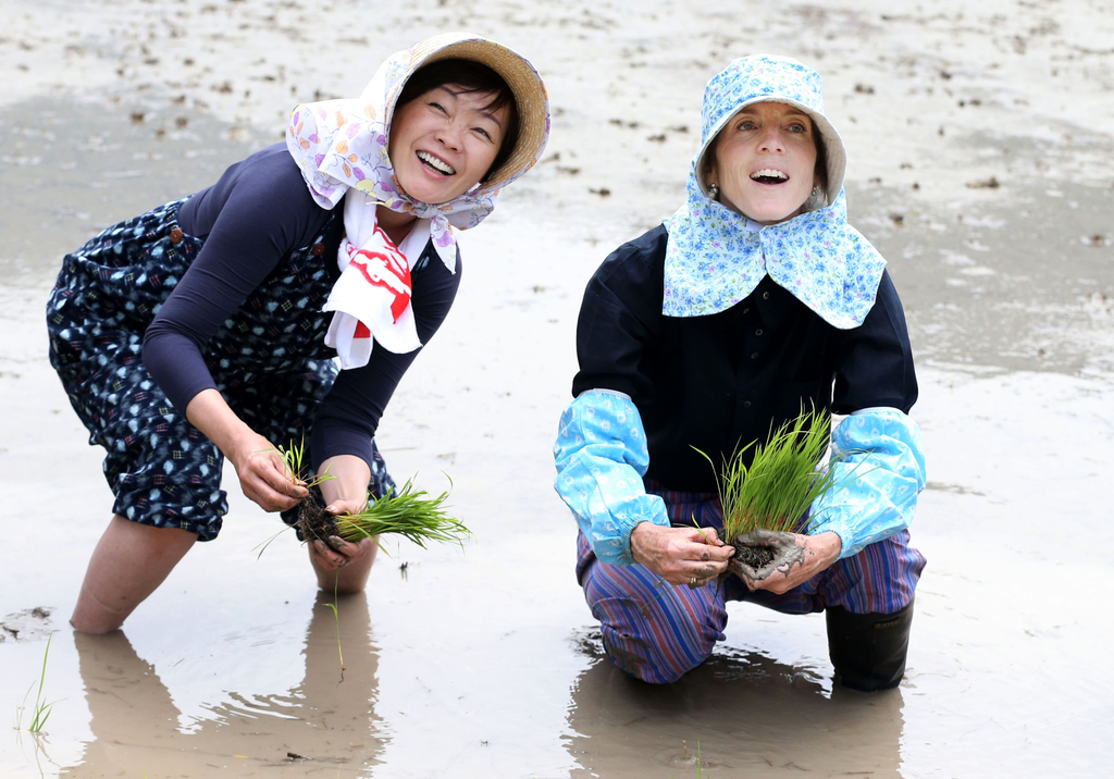 FILE - In this June 14, 2015, file photo, U.S. Ambassador to Japan Caroline Kennedy, right, and Akie Abe, wife of Japanese Prime Minist...