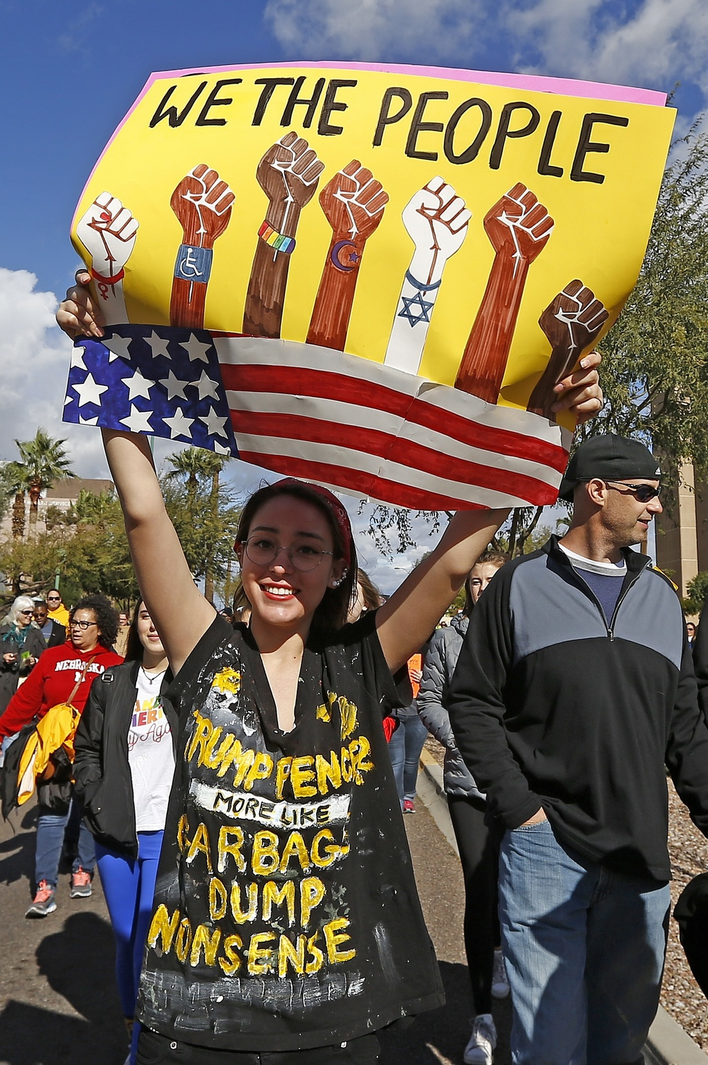 A demonstrator holds a sign as she marches in support of the Women's March on Washington Saturday, Jan. 21, 2017, in Phoenix. Thousands...