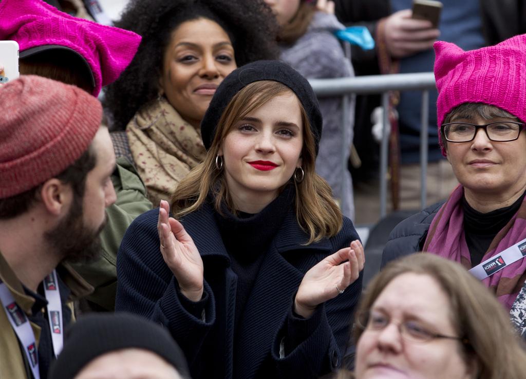 Actress Emma Watson sits in the crowd during the Women's March on Washington, Saturday, Jan. 21, 2017 in Washington. (AP Photo/Jose Lui...