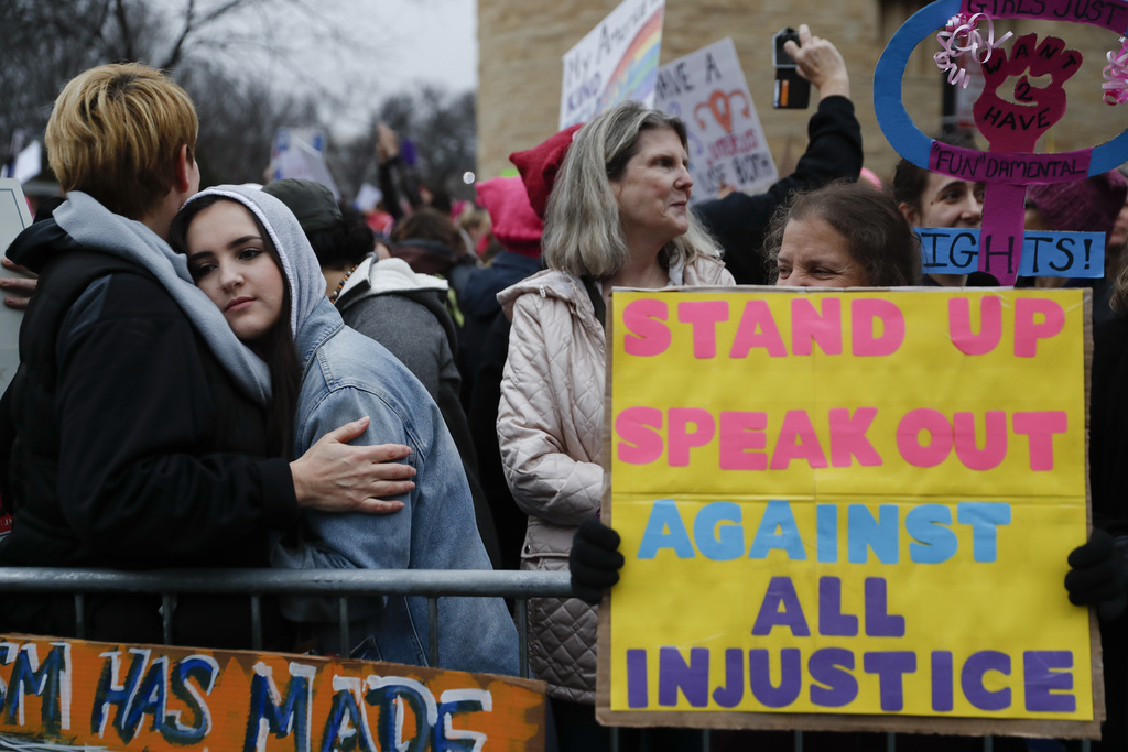 Protestors wait for speakers to begin their speeches in the cold along the barricades at the Women's March on Washington during the fir...