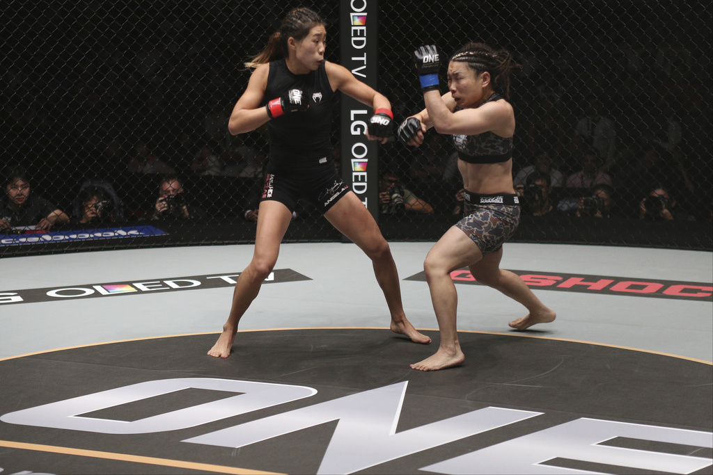 In this May 6, 2016, photo, mixed martial arts ONE Women's Atomweight World Champion Angela Lee of Singapore, left, fights Mei Yamaguch...