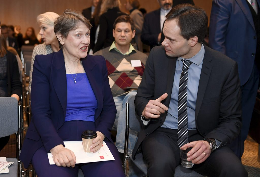 Administrator of the UNDP Helen Clark, left and Finnish Minister for Foreign Trade and Development Kai Mykk'nen talk, during  a confere...
