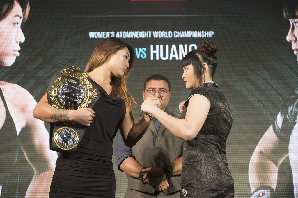 In this Jan. 17, 2017, photo, mixed martial arts ONE Women's Atomweight World Champion Angela Lee, left, poses with challenger, Jenny H...