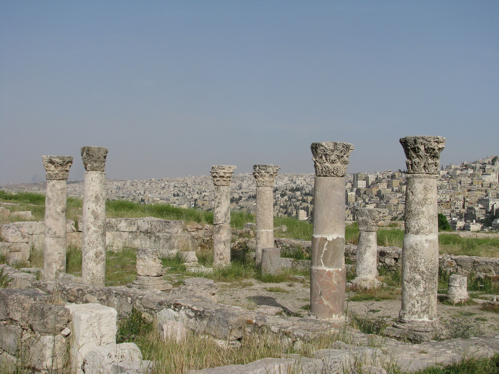 This April 21, 2016 photo shows ancient ruins on the monument-filled Citadel hill and, beyond, a panorama of Jordan's capital, Amman. T...
