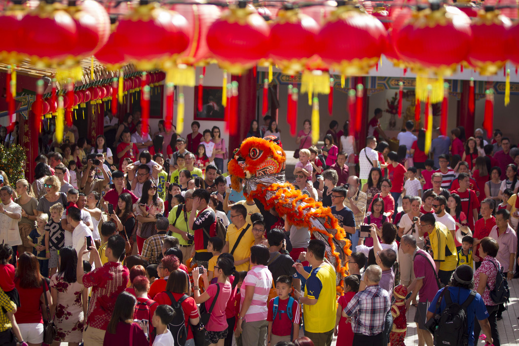 Lion dance troupe performs during the first day of Chinese Lunar New Year at a temple in Kuala Lumpur, Malaysia, Saturday, Jan. 28, 201...