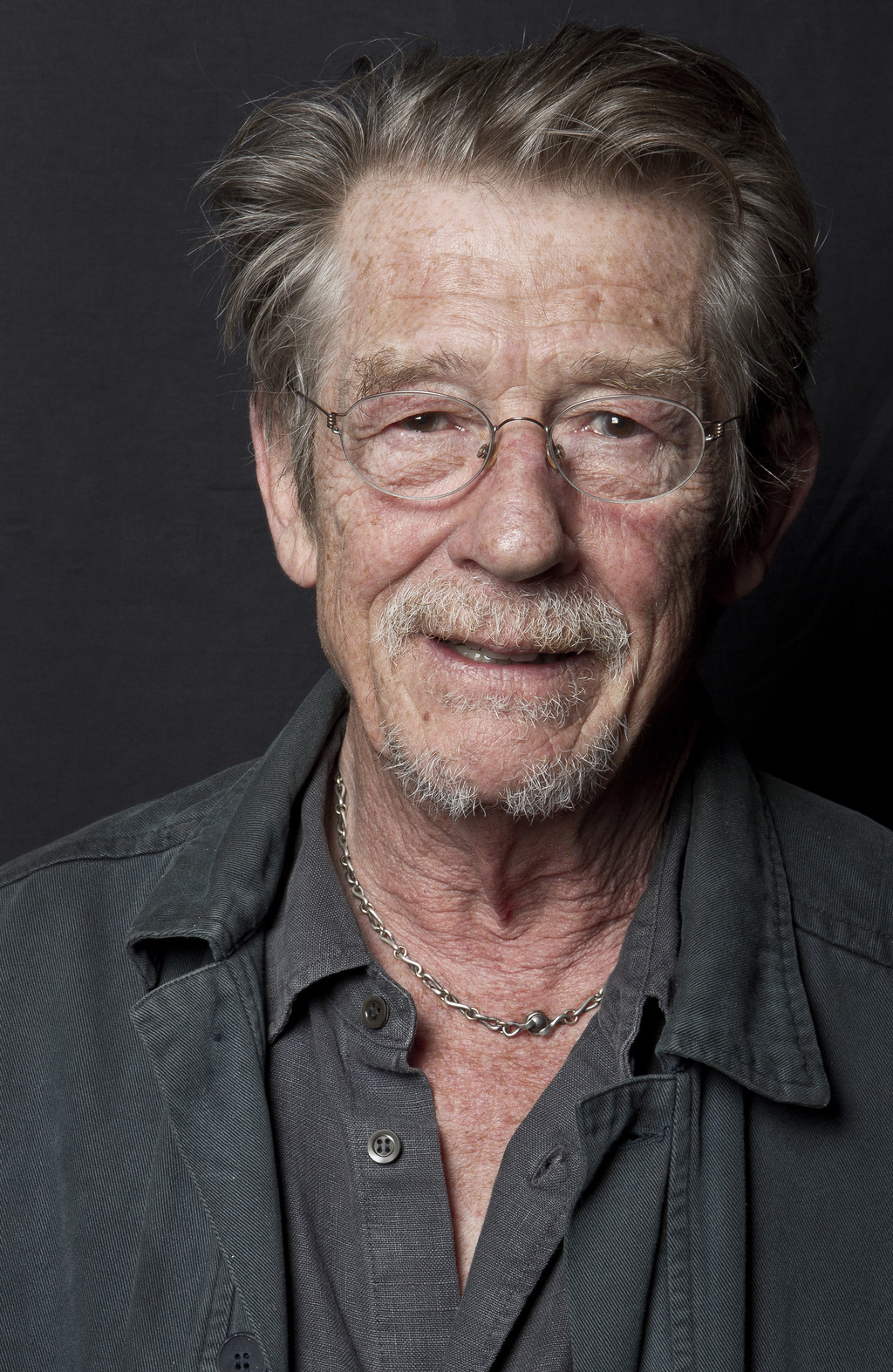 File- This Sept. 6, 2011, file photo shows British actor John Hurt posing for portraits at the Venice Film Festival Movie Star Lounge a...