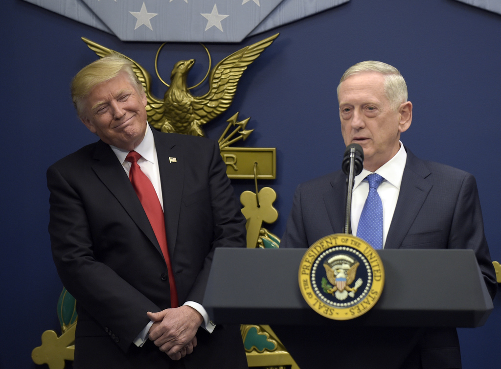 In this Jan. 27, 2017 photo, President Donald Trump, left, listens as Defense Secretary James Mattis, right, speaks at the Pentagon in ...
