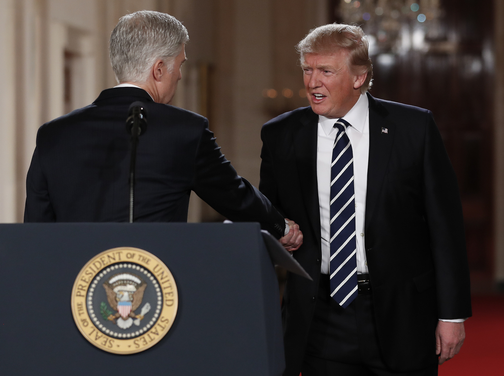 President Donald Trump shakes hands with Judge Neil Gorsuch in East Room of the White House in Washington, Tuesday, Jan. 31, 2017, afte...