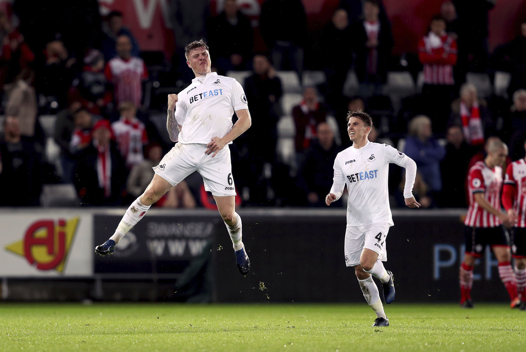Swansea City's Alfie Mawson celebrates scoring his side's first goal of the game during their English Premier League soccer match again...