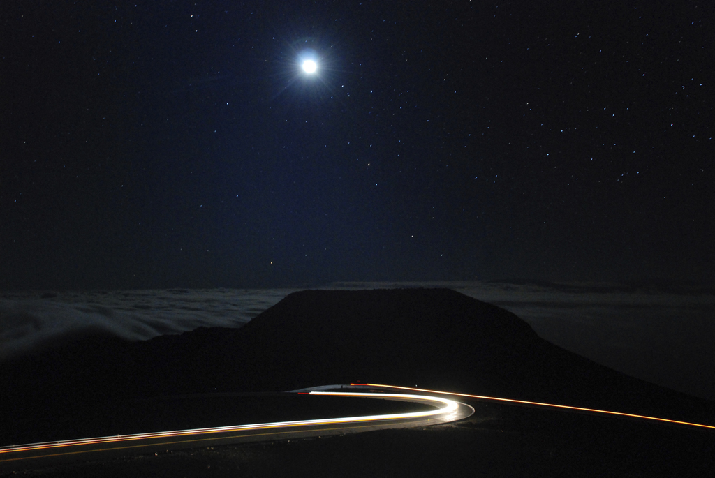 In this photo taken with a long exposure, cars drive up the access road to the summit of Haleakala volcano in Haleakala National Park h...