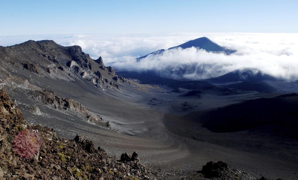 Clouds hang below the summit of Haleakala volcano in Haleakala National Park on Hawaii's island of Maui, Monday, Jan. 23, 2017. Park of...