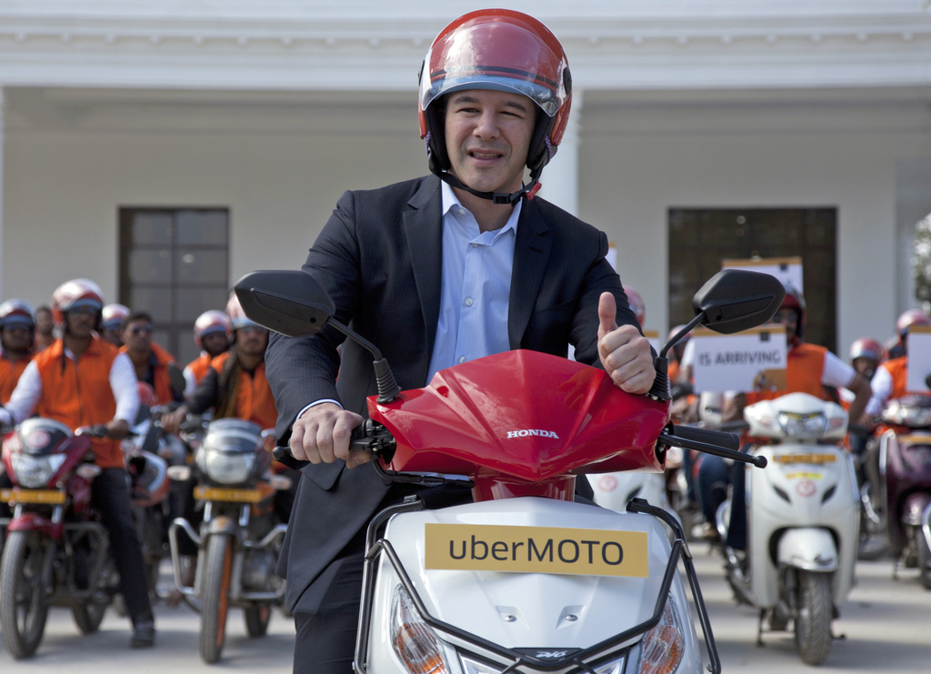 FILE - In this Dec. 13, 2016, file photo, Uber CEO Travis Kalanick, poses during the launch of its bike-sharing product, uberMOTO, in H...